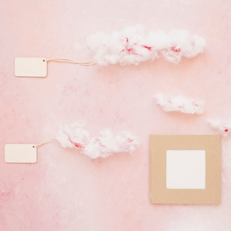 Two cloudy tags with frame on color background