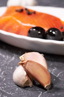 Two cloves of garlic on a salmon background. selective focus