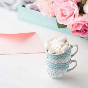 Two coffee cups with marshmallow card for valentine's or mother woman day.