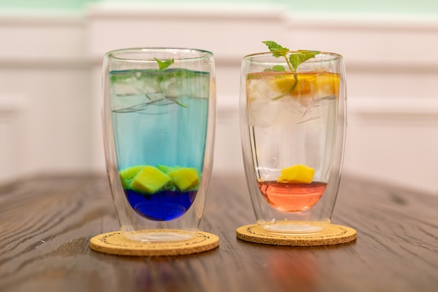 Two cold summer drinks one red and one blue