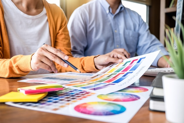 Two colleagues creative graphic designer working on color selection
