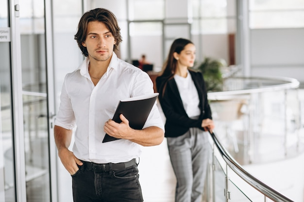 Two collegues working in a business center