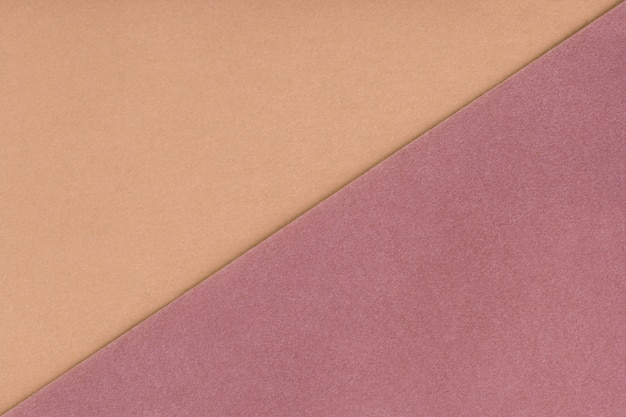 Two color background beige and brown shade. velvet texture of felt.