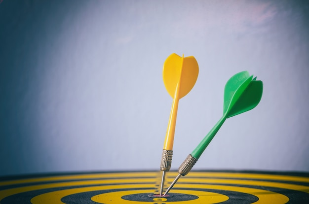 Two color dart with target arrows ,business concept of target marketing. success or goal symbol.