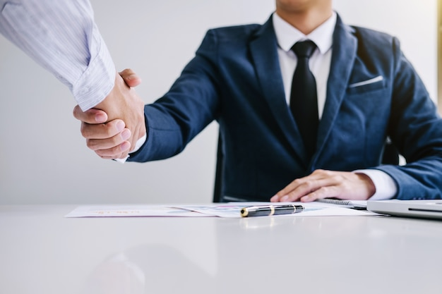 Two confident business handshake and business people after discussing good deal of trading