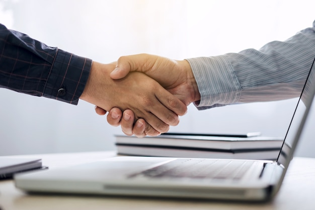 Two confident business handshake and business people after discussing good deal