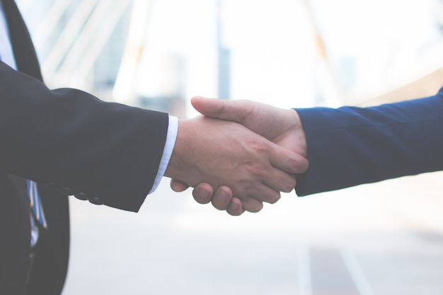 Two confident businessman shaking hands. successful business partners. negotiating busines