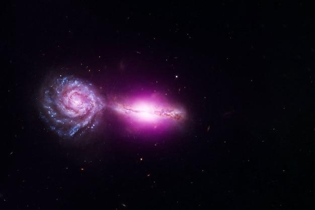 2つの接続された銀河。この画像の要素はnasaから提供されました。高品質の写真