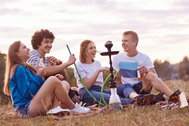 Two couple have joy together while have picnic outdoor