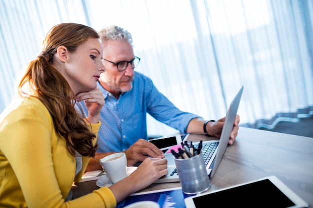 Two coworkers using a computer