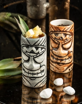 Two creative cups of cocktails