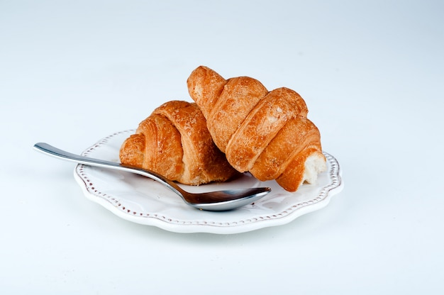 Two croissants on a saucer sweets