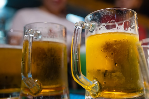 Two cups of beer in a pub in new zealand. concept photo of drinking beer and alcohol.