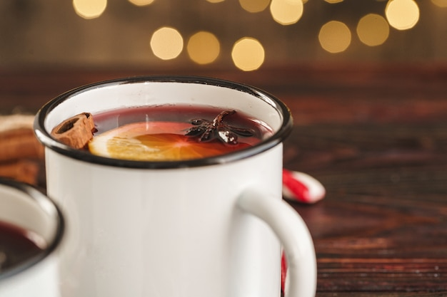 Two cups of christmas mulled wine on a wooden table