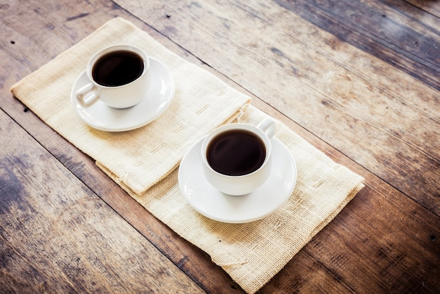 Two cups of coffee on brown napkin