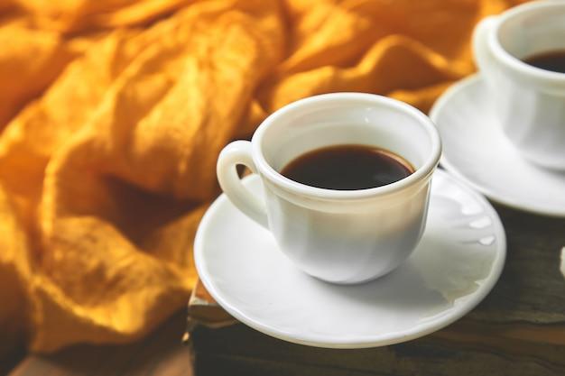 Two cups of coffee espresso near sugar cube