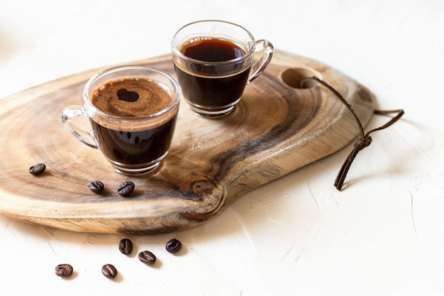 Two cups of coffee espresso,   on wooden background.