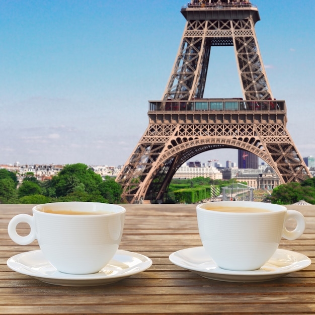 Two cups of coffee in paris cafe with view of eiffel tower