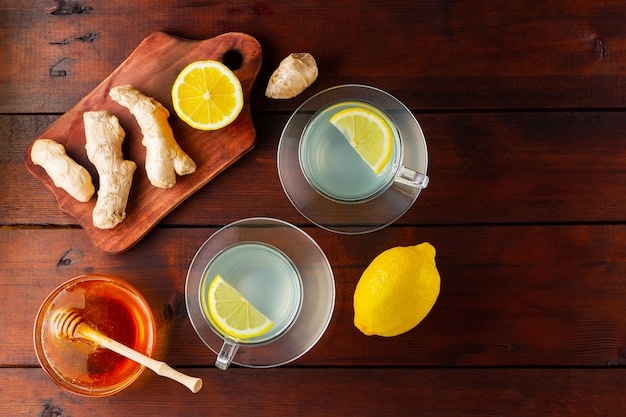 Two cups of ginger tea with lemon and honey