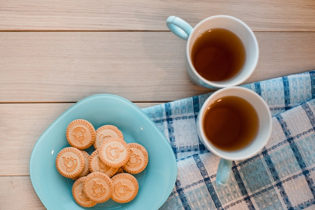 Two cups of tea on a blue napkin
