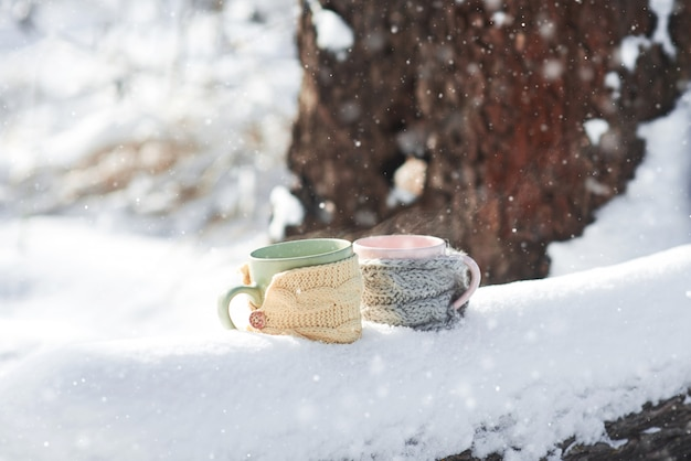 Two cups of tea on  of a winter landscape