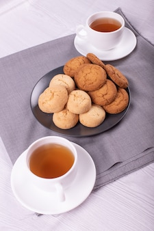 Two cups of tea with biscuits. teatime