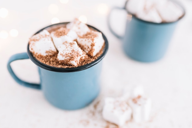 Two cups with cocoa and soft marshmallows