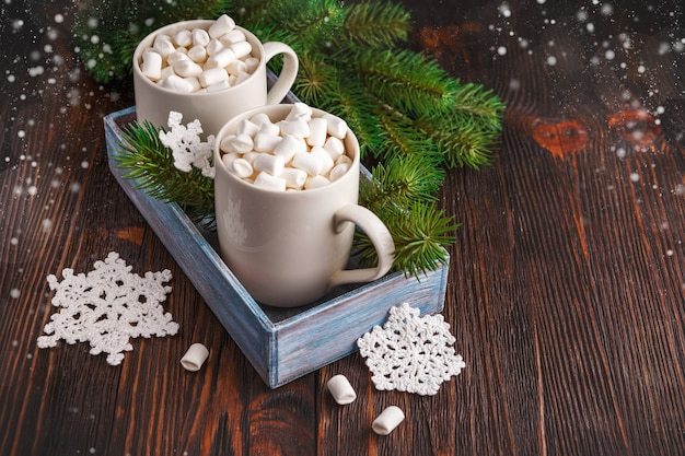 Two cups with small marshmallows