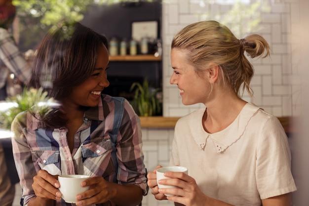 Two customers drinking coffee