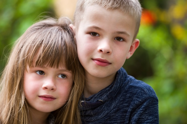 Two cute fair-haired children siblings