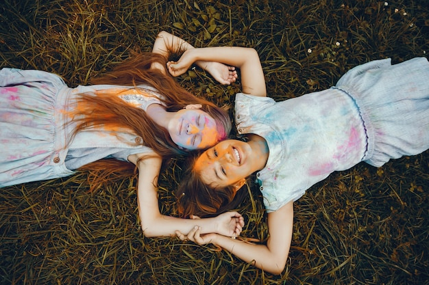 Two cute girls have fun in a summer park