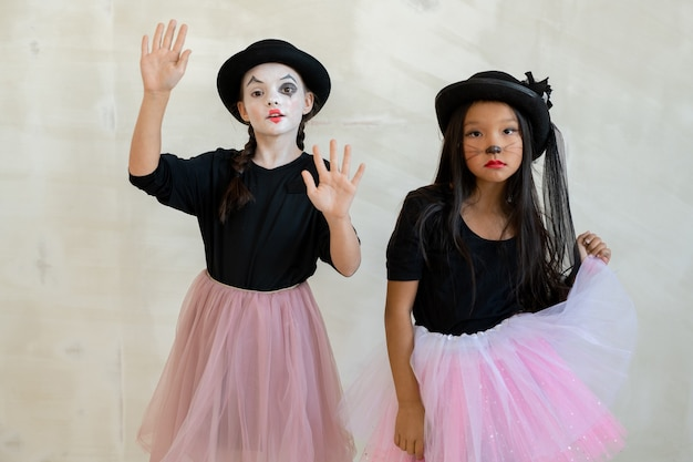 Two cute girls with halloween makeup doing pantomime