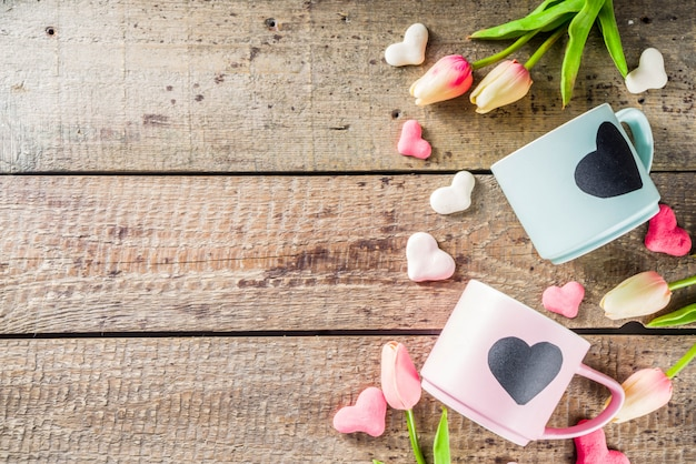 Two cute tea cups with chalkboard hearts