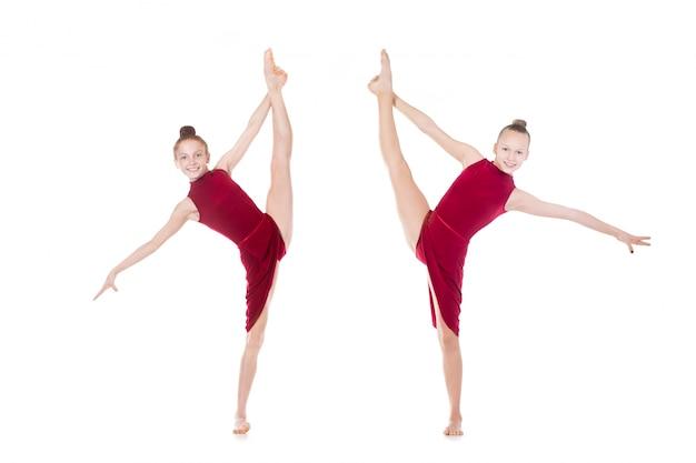 Two dancer girls doing standing splits