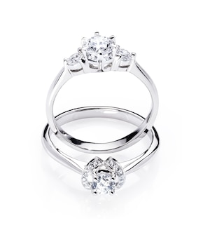 Two diamond engagement wedding rings on isolated white background