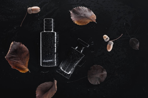 Two different perfumes on a dark background