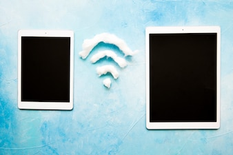 Two digital tablet with wifi symbol
