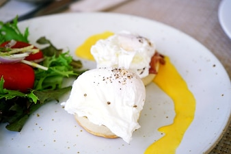 Two eggs benedicts, breakfast menu, eggs, english muffin, canadian bacon and Hollandaise s