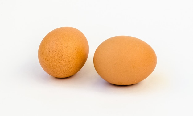 Two eggs isolated in white background.