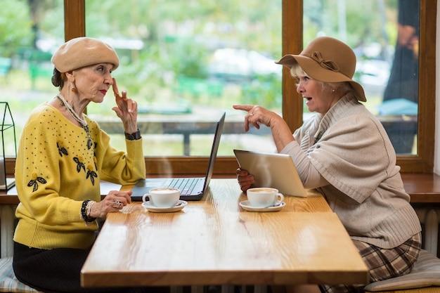 Two elderly women in cafe