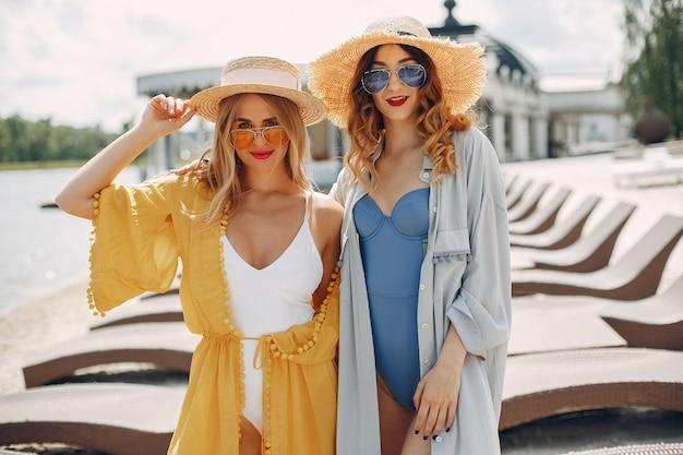 Two elegant girls on a resort