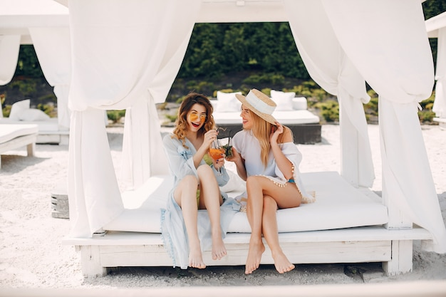 Two elegant girls on a resort