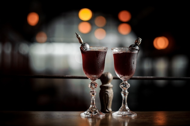 Two elegant glasses filled with fresh sweet and strong summer arnaud cocktail