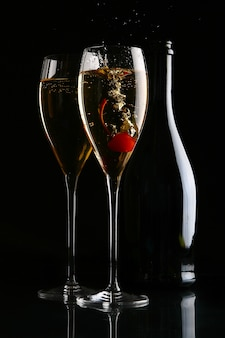 Two elegant glasses with champagne and cherry