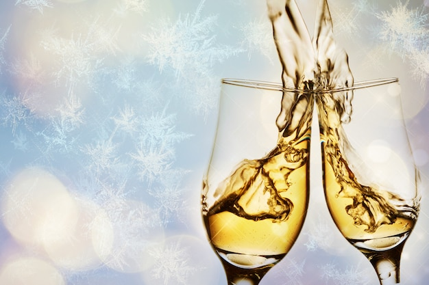 Two elegant glasses with sparkling champagne with splash