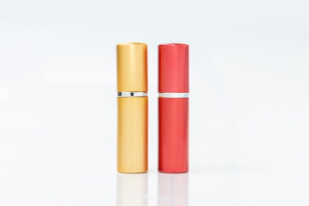 Two elegant makeup or lipstick  containers