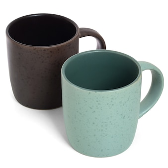 Two empty ceramic mugs on white