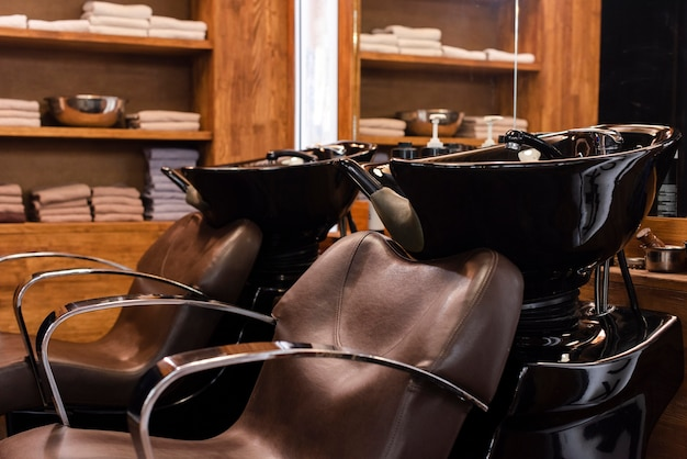 Two empty chairs in barber shop