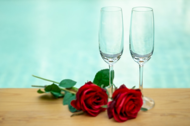 Two empty champagne glasses with rose flower