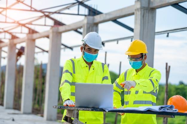 Two engineers checking production process in building construction site